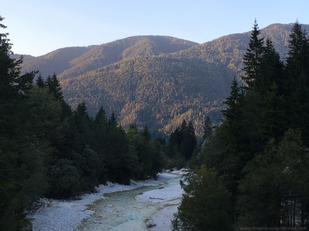 An evening walk along the river in Kranjska Gora, the fantastic Slovenian mountains in the background