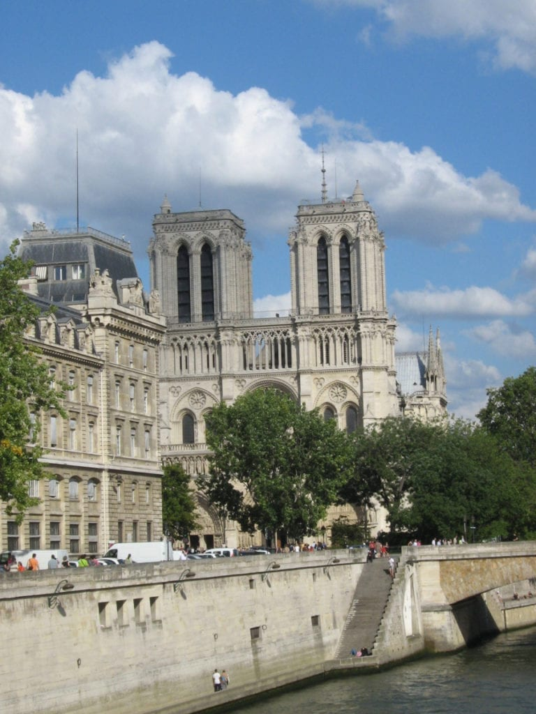 The Notre Dame cathedral has a beautiful facade, but it is best enjoyed from the side (three days in Paris itinerary)
