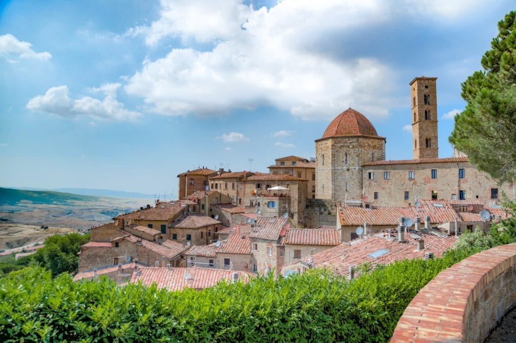 Driving in Tuscany - panoramic view over the Italian town of Volterra