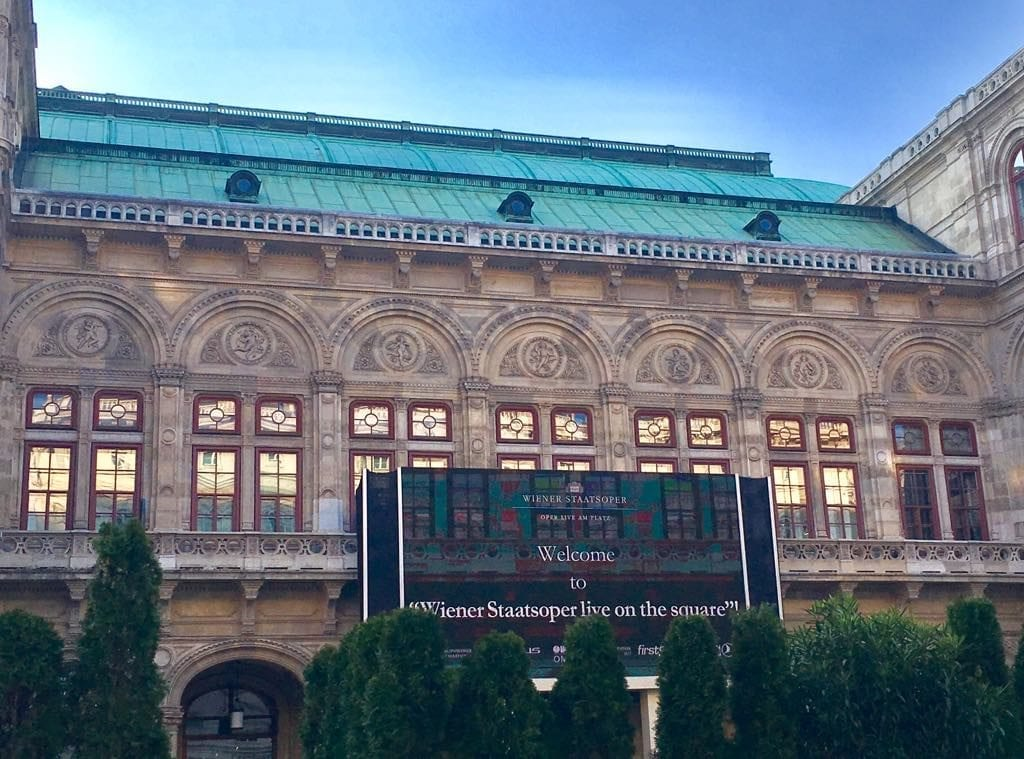 Best time to visit Vienna - a giant screen on the Herbert von Karajan Square streams live performances from the Vienna State Opera as soon as the weather allows it