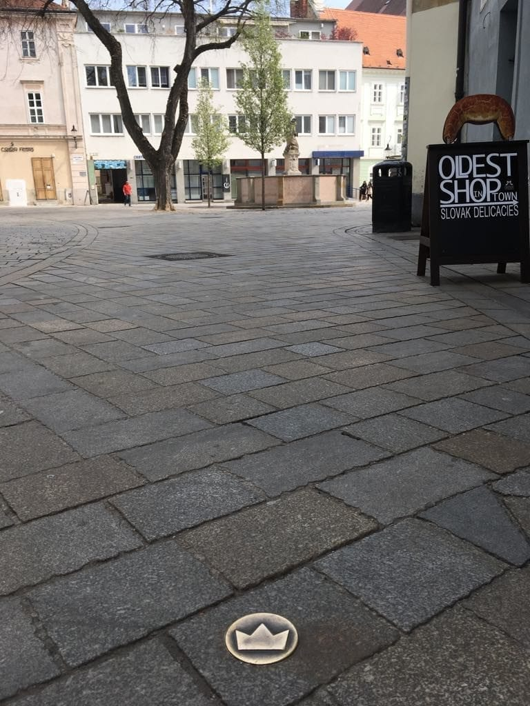 A series of crowns in the pavement in Bratislava, Slovakia mark the old coronation route for the kings of Hungary.