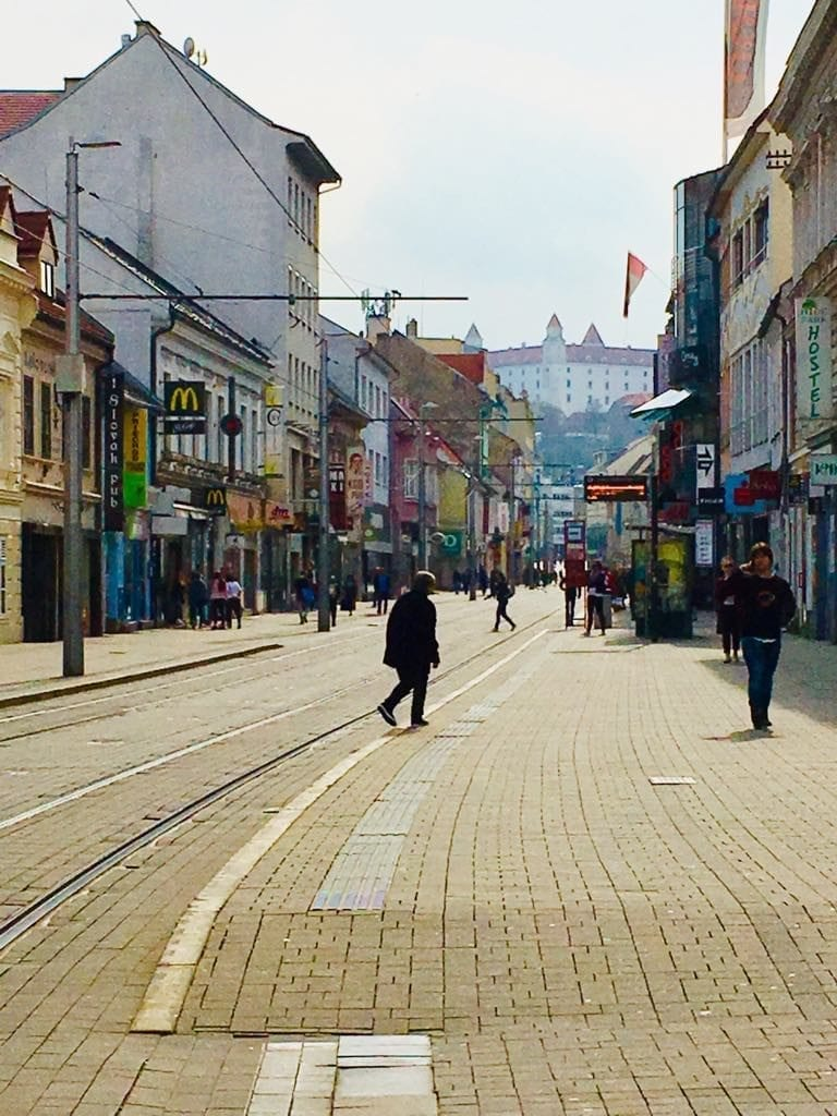 A shopping street with view of the castle on a Sunday afternoon - Bratislava, Slovakia