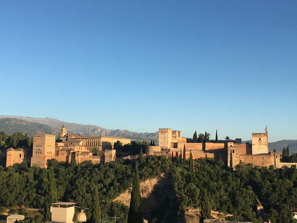 Sunset view over the Alhambra, from the garden of the nearby Mezquita Mayor de Granada