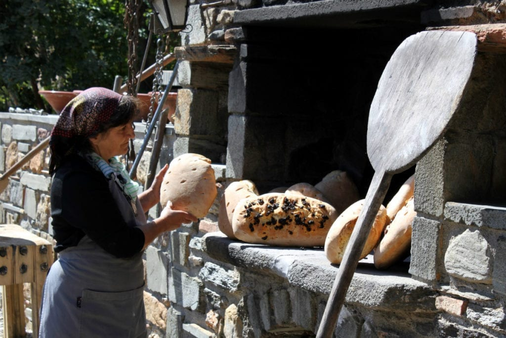 Baking bread at Kinsterna Hotel in Monemvasia