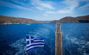 Greece flag seen from a moving ship